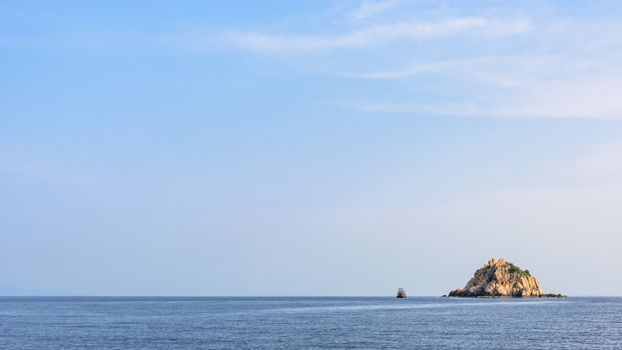 Beautiful nature landscape of Shark Island Divesite small rock island at Ko Tao under the blue sky on the sea in summer is a famous attractions in the Gulf of Thailand, Surat Thani, 16:9 widescreen