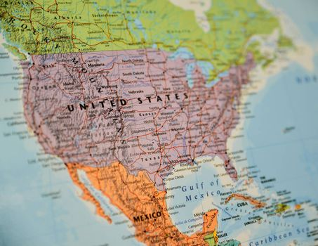Closeup shot of North America topographic map, centred on the United States. Shallow depth of field.