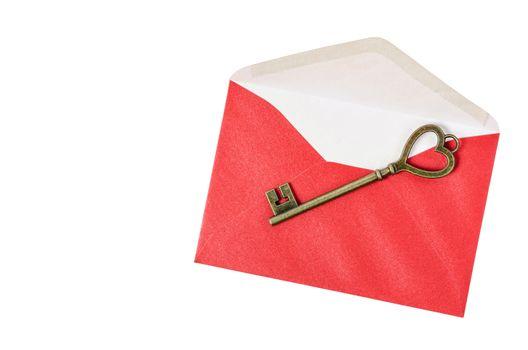 Vintage key on red envelope.