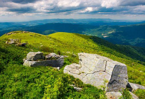 boulders on grassy hills