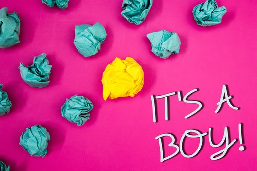Conceptual hand writing showing It S A Boy Motivational Call. Business photo showcasing Male baby is coming Gender reveal CelebrationIdeas words pink background white letters crumpled papers