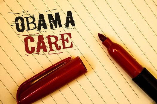 Text sign showing Obama Care. Conceptual photo Government Program of Insurance System Patient ProtectionIdeas messages created on notebook page black red letters open pen resting