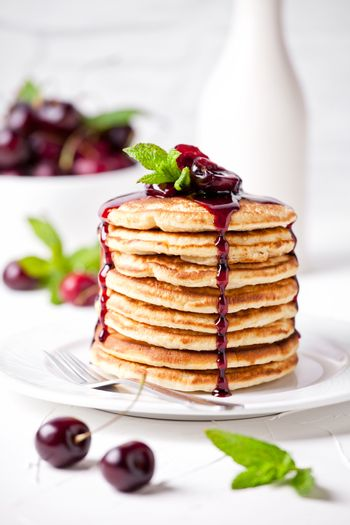 Stack Of Pancakes With Cherry Topping