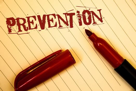 Text sign showing Prevention. Conceptual photo Stopping something from happening Healthcare ProtectionIdeas messages created on notebook page black red letters open pen resting
