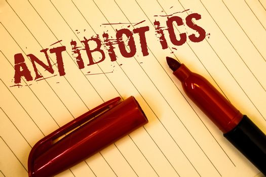 Text sign showing Antibiotics. Conceptual photo Drug used in treatment and prevention of bacterial infectionsIdeas messages created on notebook page black red letters open pen resting