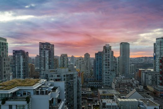Sunrise over city downtown condominiums Vancouver BC British Columbia Canada
