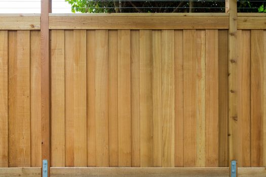 New Cedar Wood Fence around house garden property front view closeup