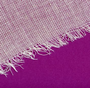 Canvas texture with fringe. White and violet