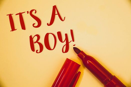 Handwriting texts It S A Boy Motivational Call. Concept meaning Male baby is coming Gender reveal CelebrationIdeas messages words red letters created on vintage background open pen