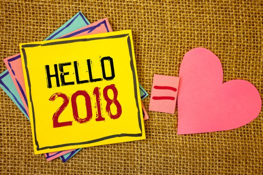 Conceptual hand writing showing Hello 2018. Business photo texts Starting a new year Motivational message 2017 is over nowIdeas created on note papers equal sign heart wicker background