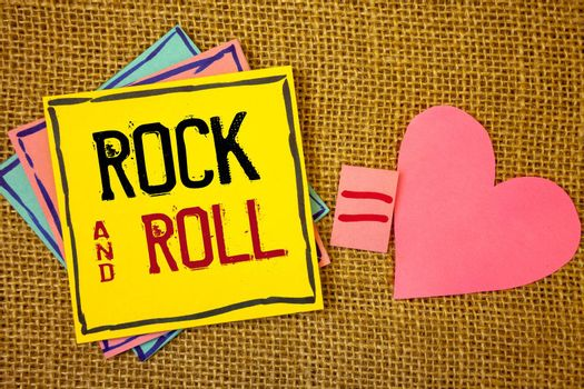 Conceptual hand writing showing Rock and Roll. Business photo texts Musical Genre Type of popular dance music Heavy Beat SoundIdeas created on note papers equal sign heart wicker background