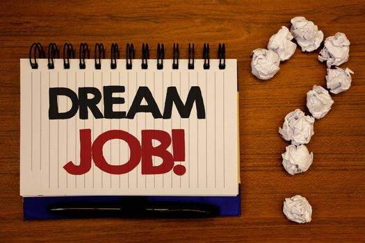 Text sign showing Dream Job Motivational Call. Conceptual photo To work in what you like Fulfilling activitiesIdeas on notebook wooden background quotation mark made of crumpled papers