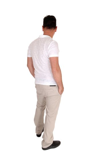 A tall handsome middle age man standing in a beige slacks and white t-shirt  with his hands in his pocket, from the back, isolated for white background
