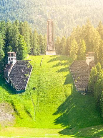 Old abandoned ski jump in Cortina d'Ampezzo - place of Winter Olympics in 1956 - in summer season. Dolomites, Italy