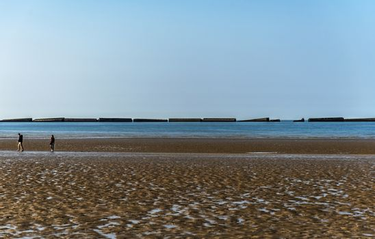 The remains of the Mulberry Harbour at Arromanches, Normandy France