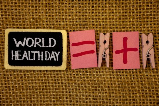 Writing note showing  World Health Day. Business photo showcasing Special Date for Healthy Activities Care Prevention Ideas on blackboard chalk letters equal plus signs cloth pins wicker