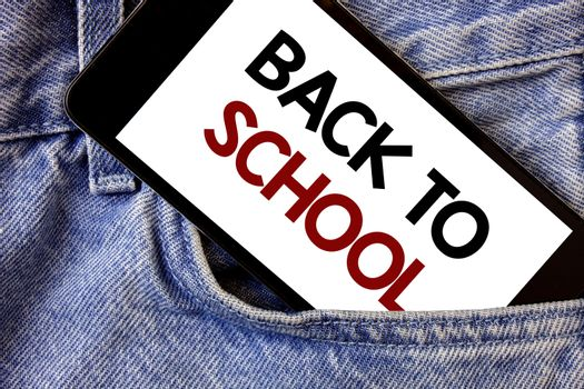 Word writing text Back To School. Business concept for Return to class first day of studies Classroom Arriving Text two Words written black Phone white Screen front pocket blue jeans