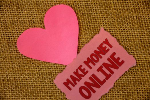 Conceptual hand writing showing Make Money Online. Business photo text Business Ecommerce Ebusiness Innovation Web Technology Text pink torn paper note heart love message letter