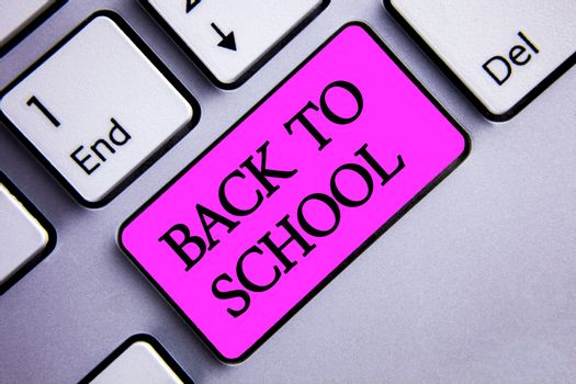 Writing note showing  Back To School. Business photo showcasing Return to class first day of studies Classroom Arriving Text two words pink insert button key press on grey computer