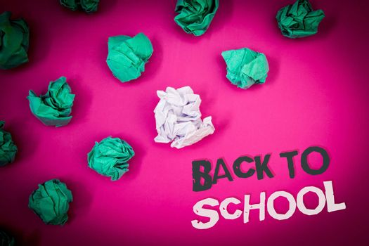 Writing note showing  Back To School. Business photo showcasing Return to class first day of studies Classroom Arriving Text Words pink background crumbled paper notes stress written angry