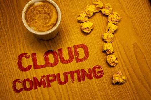 Text sign showing Cloud Computing. Conceptual photo Online Information Storage Virtual Media Data Server Words written Desk Coffee White mug crumbled paper notes question mark