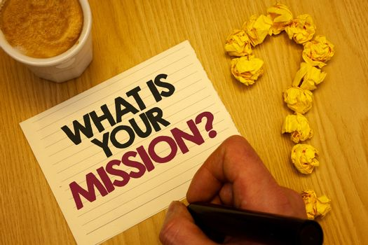 Conceptual hand writing showing What Is You Mission Question. Business photo showcasing asking someone about his plans and to-do list Wooden desktop hand hold marker page coffee question mark