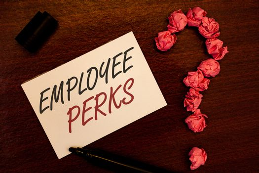 Text sign showing Employee Perks. Conceptual photo Worker Benefits Bonuses Compensation Rewards Health Insurance Text white paper note black marker open cap pink crumbled paper question
