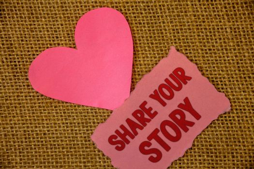 Conceptual hand writing showing Share Your Story. Business photo text Experience Storytelling Nostalgia Thoughts Memory Personal Text pink torn paper note heart love message letter