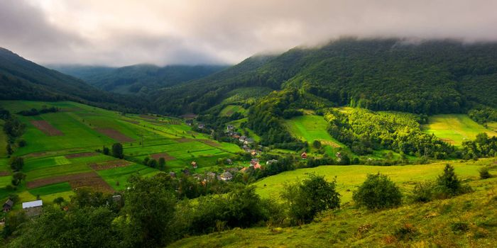 Abranka village in Carpathian mountains. lovely rural scenery on a cloudy sunrise.
