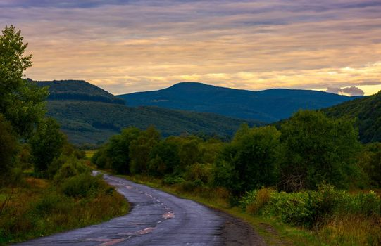 mountainous road on cloudy sunrise. lovely landscape in early autumn