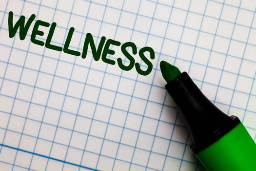 Writing note showing Wellness. Business photo showcasing Making healthy choices complete mental physical relaxation Graph paper marker pen ideas theories practical work important white