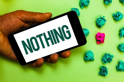Conceptual hand writing showing Nothing. Business photo text Not anything No single thing or value Absence of progress Blank Text message smart screen mobile handset crumpled small balls