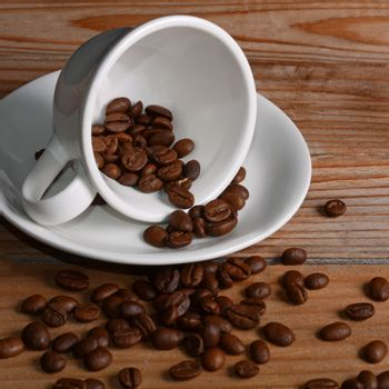 The coffee beans in a cup close-up