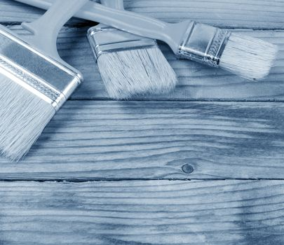 Brush for painting paint on wooden background