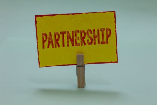 Conceptual hand writing showing Partnership. Business photo text Association of two or more people as partners Cooperation Unity Display yellow sticky card convey messages idea notice office