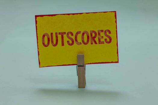 Conceptual hand writing showing Outscores. Business photo text Score more point than others Examination Tests running Health care Display yellow sticky card convey messages idea notice office