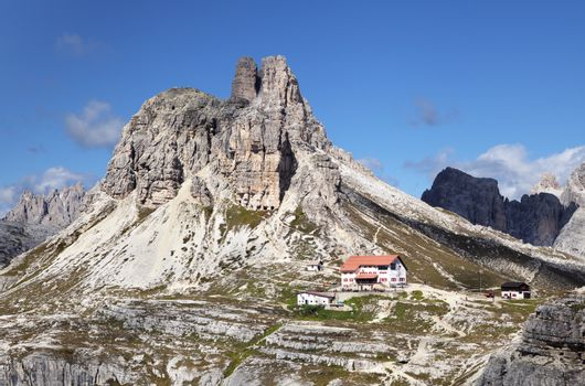 ITALY, DOLOMITES - SEPTEMBER 22, 2014 - Landscape with a refuge in Dolomites mountains