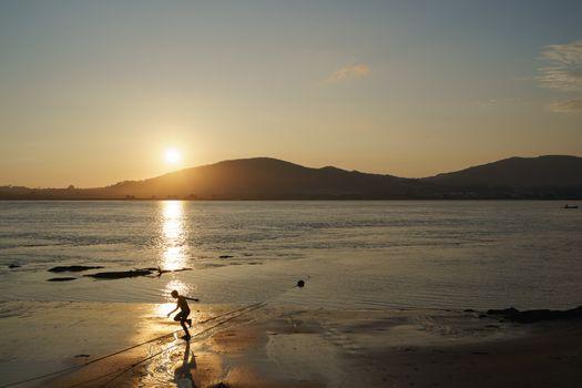 Child running in the last sun rays