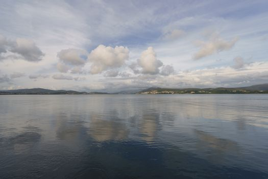 The river flows into the Atlantic Ocean here. The place where the sky converges with the earth, clouds reflect in water