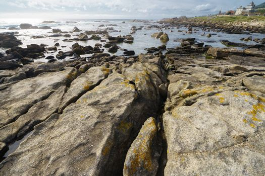 Waters of the Atlantic Ocean remained in the crevices and pits of stones after the tide