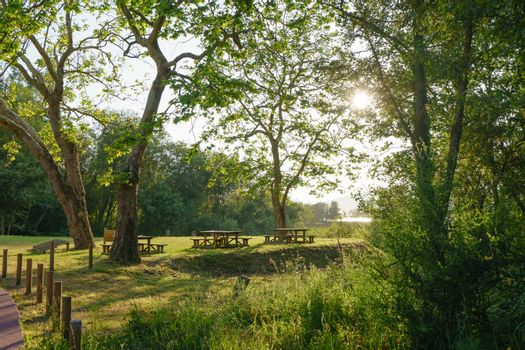 Sunny landscape near the river Minya (Minha), nothern Portugal. Picnic area in the park