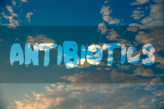 Conceptual hand writing showing Antibiotics. Business photo showcasing Antibacterial Drug Disinfectant Aseptic Sterilizing Sanitary Ideas message reflection cloudy sky sunset natural landscape