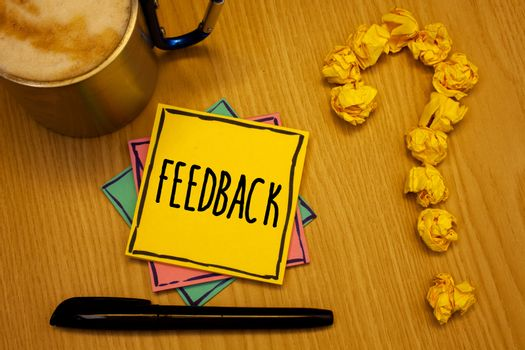 Writing note showing  Feedback. Business photo showcasing Customer Review Opinion Reaction Evaluation Give a response back Message wood table coffee cup question mark crumpled papers