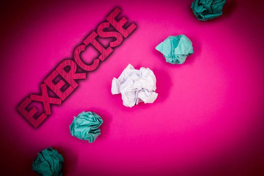 Conceptual hand writing showing Exercise. Business photo text Activity requiring physical effort Bringing into play Training Ideas messages pink background crumpled papers several tries