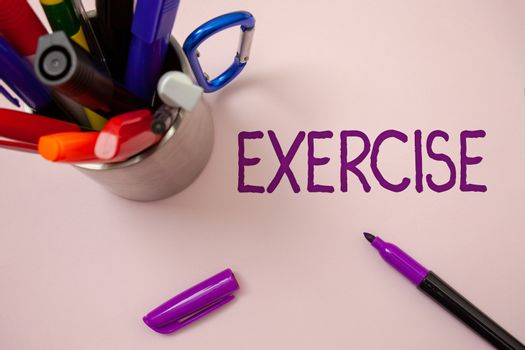 Handwriting text writing Exercise. Concept meaning Activity requiring physical effort Bringing into play Training White background purple pen markers ideas messages inspirational inspire