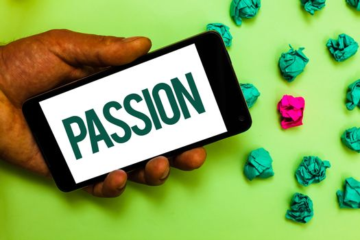 Conceptual hand writing showing Passion. Business photo text Strong and uncontrollable emotion Powerful feeling Sexual attraction Text message smart screen mobile handset crumpled small balls