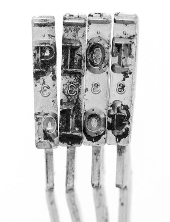 The word  PLOT with old typewriter hammers