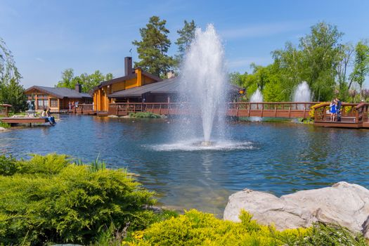 ornamental pond or lake with fountains, wooden buildings for rec