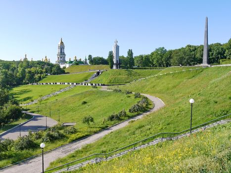 A green slope with woven sidewalks for descent near the Cathedral of St. Sophia of Kiev