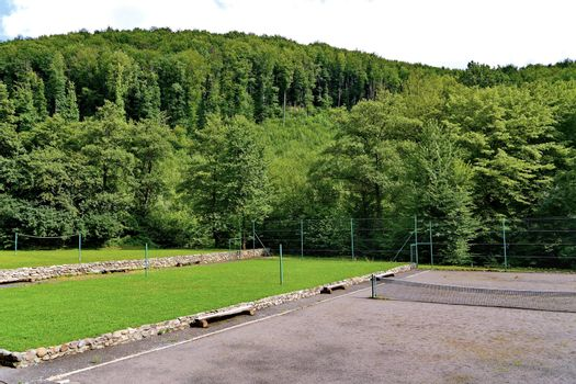 a playground in a dense mountain forest